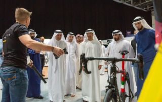 Man presenting a bike to attendees at the Extreme Sports Expo